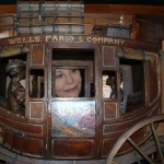 Silver Reef Museum, Leeds, Utah, Karen Kondazian with a miniature stage coach,  May 12, 2012